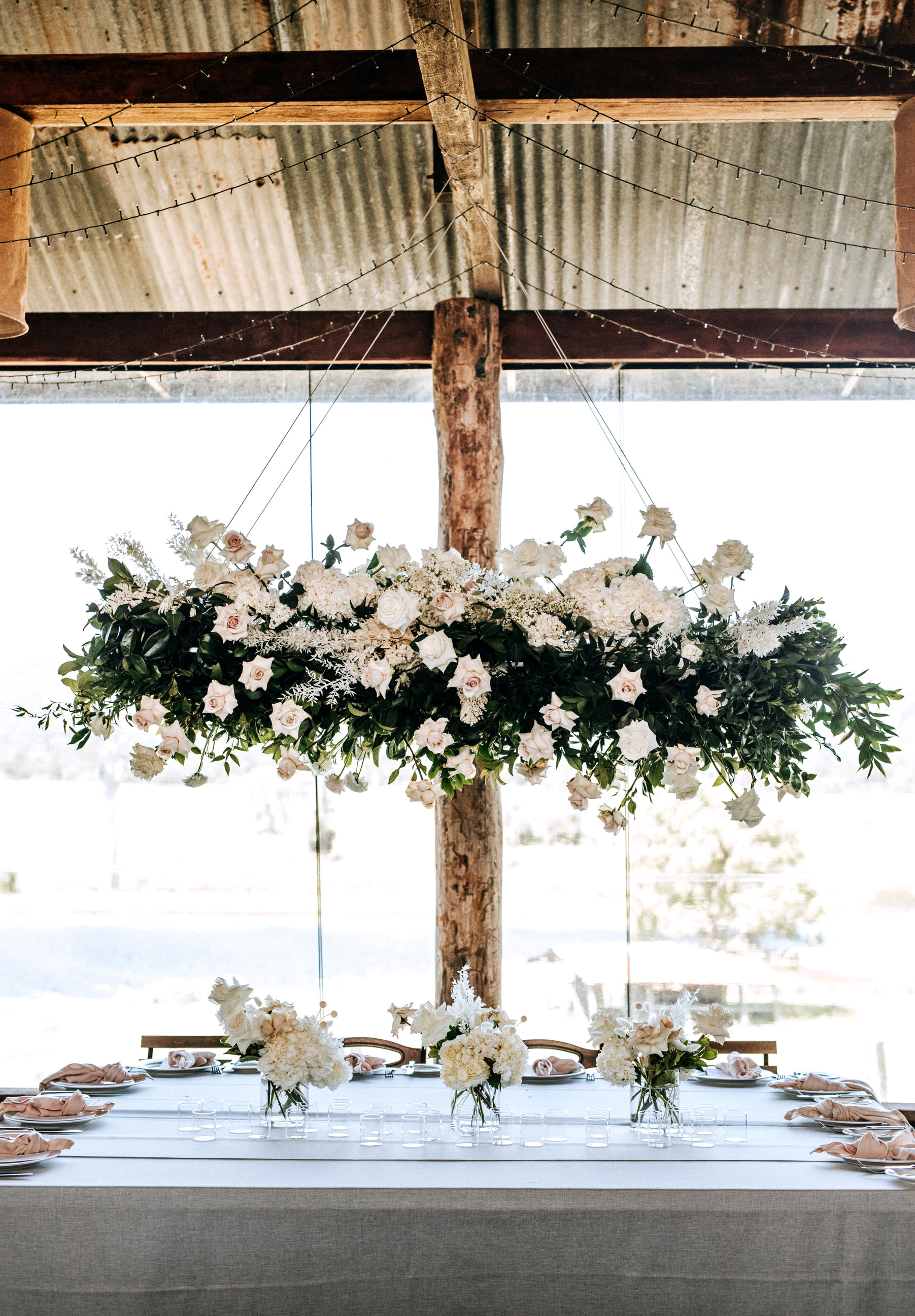 Hanging installation with lush greenery and pastel blooms