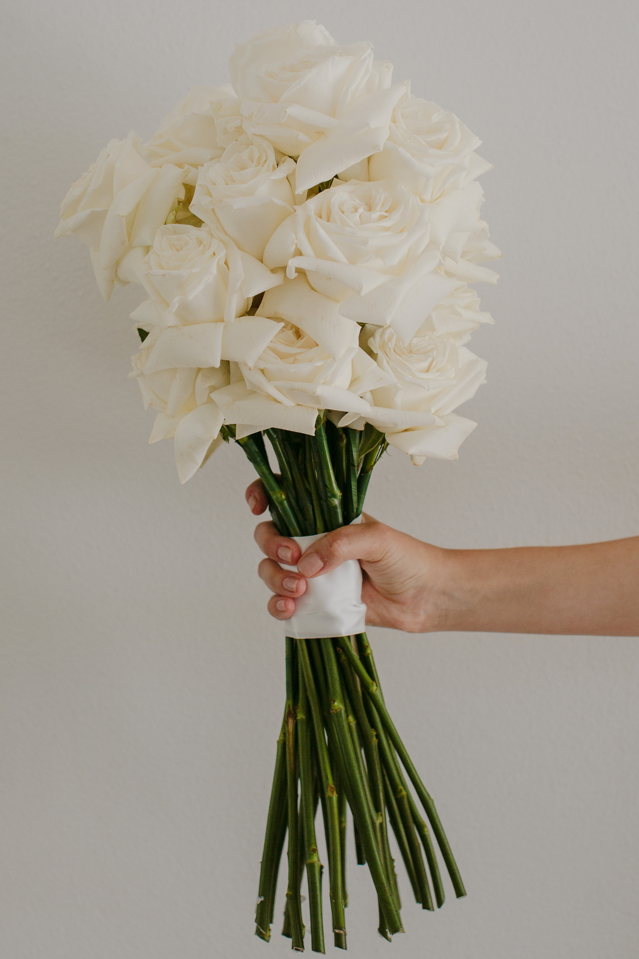 Long stem white rose wedding bouquet