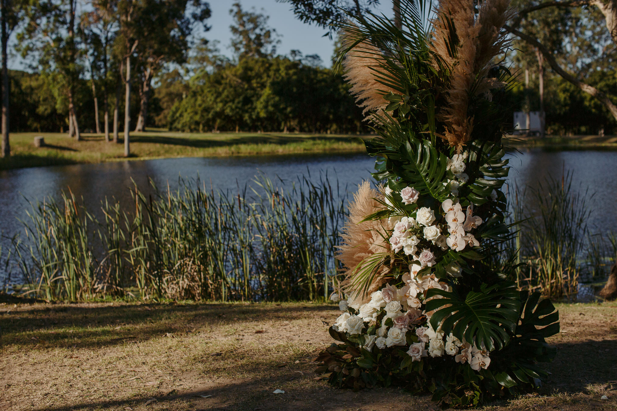 Free standing ceremony design featuring pampas grass
