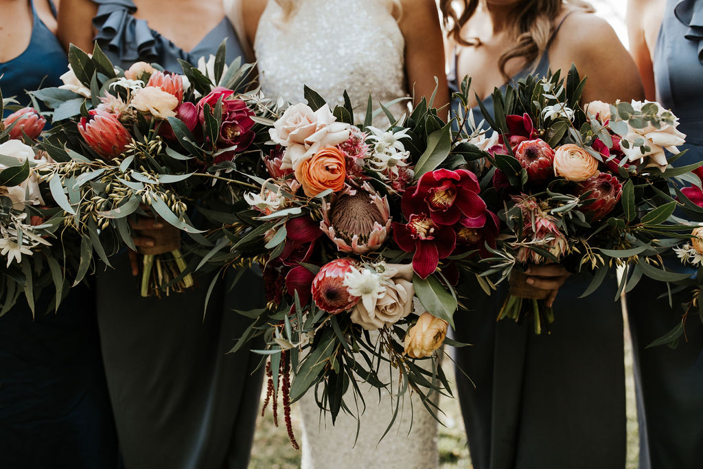 Burgundy native wedding flowers with peach tones
