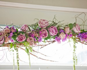Suspended blooms in rustic arch structure