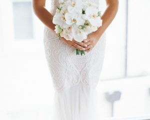 White wedding bouquet featuring orchids