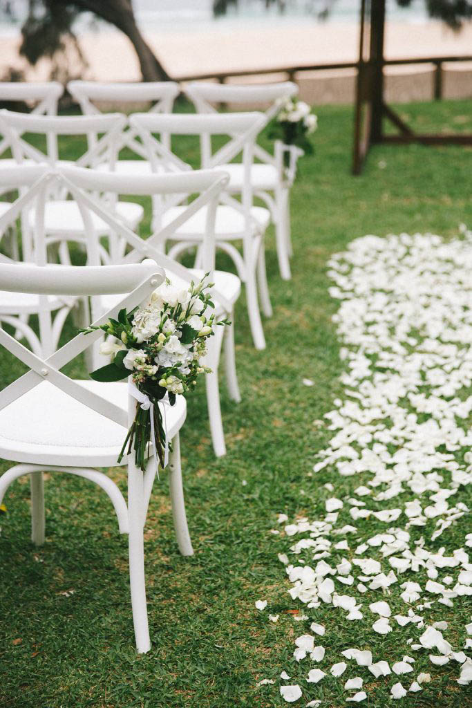 white rose petal path and chair posies