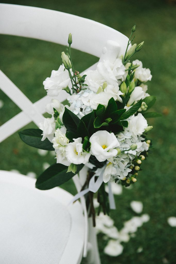 White chair posies
