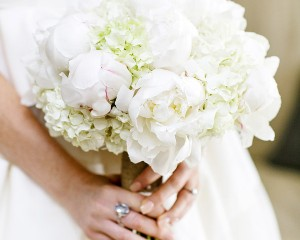 Hand held posy of peonies and hydrangea.