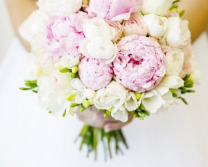 Hand held bouquet of peonies, David Austin roses and freesias.