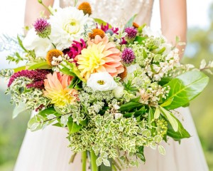 Rustic country bouquet with dahlias, lisianthus, allium, and flowering foliages and fillers Image by Calli B Photography