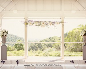 Hanging structure with suspended blooms on a rustic structure