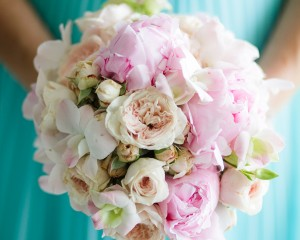 Sweet posy of David Austin roses, peonies and Singapore orchids. Image by Karen Buckle Photography.