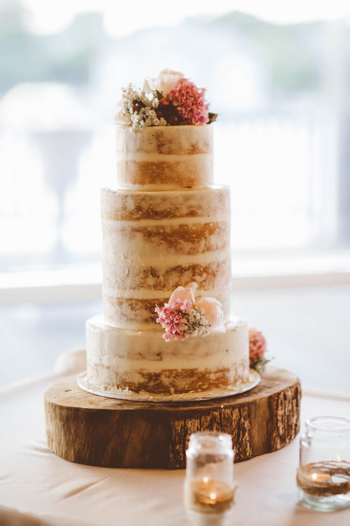 Semi Naked cake with small groupings of florals