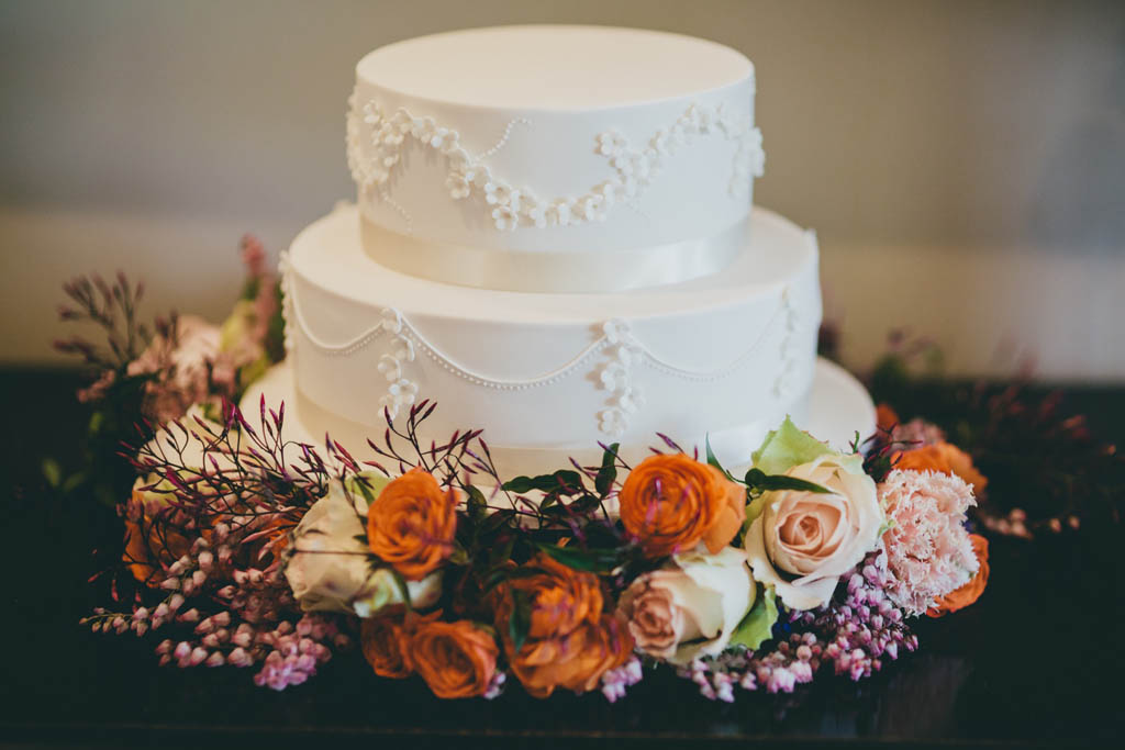 Cake by Cake Designs with a garland of floral blooms