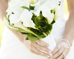 Unstructured posy of white calla lilies. Image by Calli B Photography.