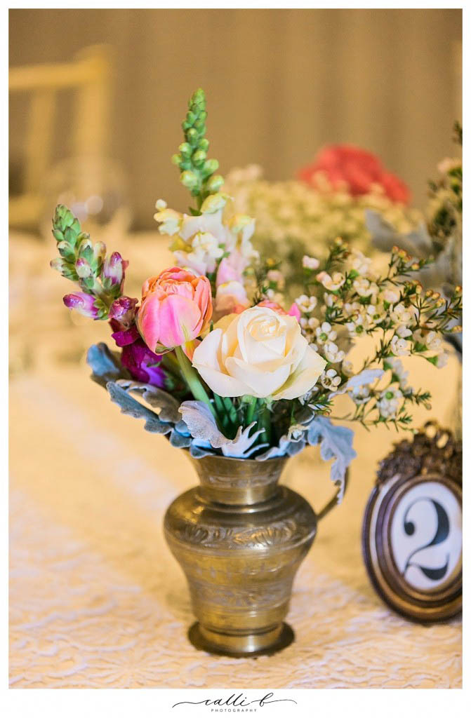 brass vases with snapdragons