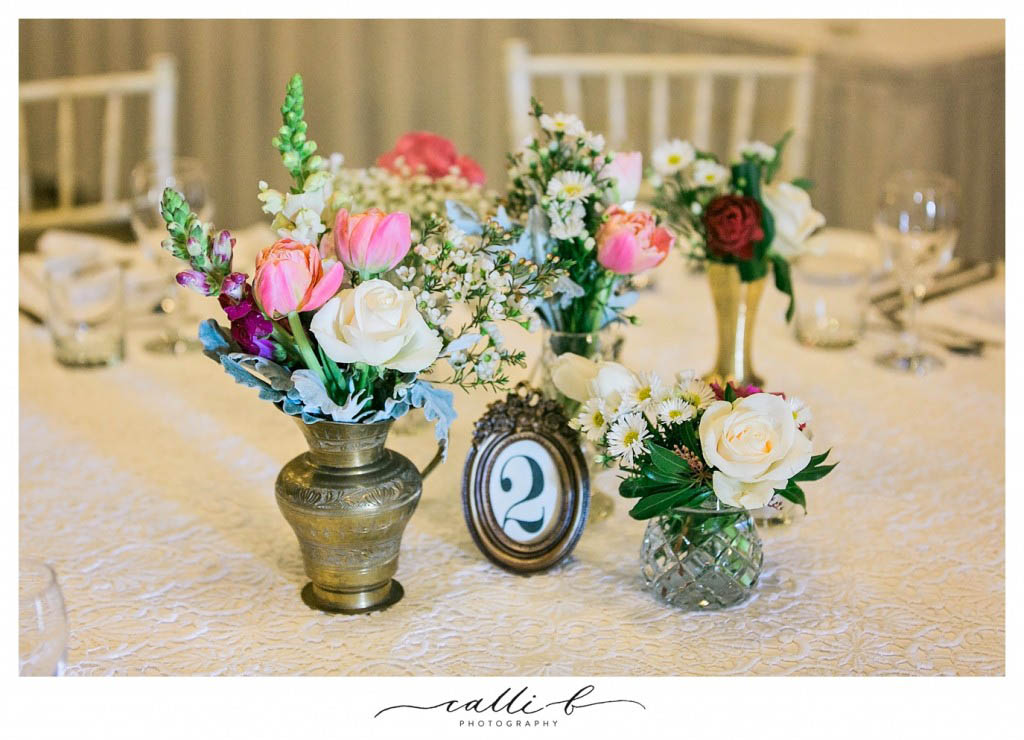 brass and crystal centrepieces featuring roses