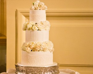 Pillar cake with floral filled tiers