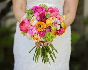 Hand held bouquet of peonies, David Austin roses, button chrysanthemums, ranunculus and succulents. Image by Calli B Photography