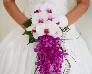Trailing bouquet of vanda orchids and Phalaenopsis orchids, feature vine and hosta leaves - Image by Calli B Photography