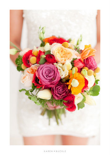 Roses, poppies, anenomes, ranunculas, billy buttons and geranium foliage - Image by Karen Buckle Photography