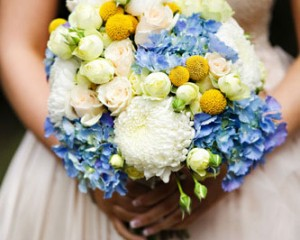 Unstructured posy bouquet of hydrangea, roses, dahlias and billy buttons - Image by Calli B Photography