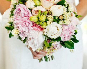 Hand held unstructured bouquet of peonies, David Austin roses, lisianthus ..