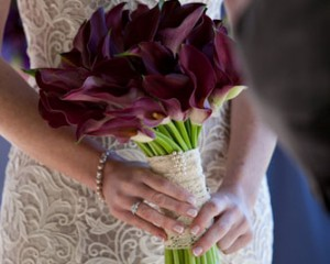 Hand held bouquet of calla lilies - Image by Focus Films