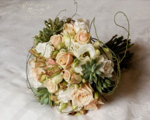 Hand held bouquet of calla lilies, tulips and roses - Image by Jodi McDonald