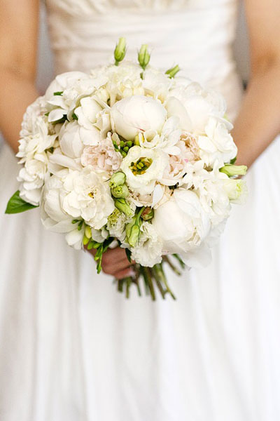Hand held posy bouquet of peonies, Lisianthus and gardenia blooms - Image by Calli B Photography