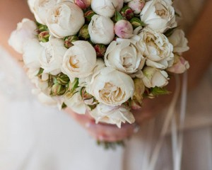Hand held bouquet of David Austin roses and natural buds.