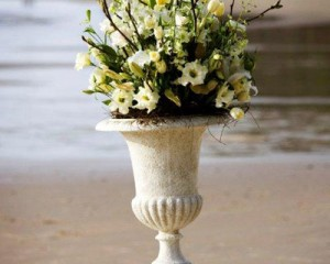 Pedestal design of tulips, lilies, lisianthus, orchids and feature willow branches - Image by Calli B Photography