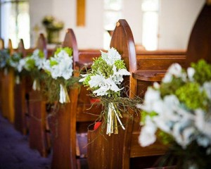 Rustic pew posies of dusty miller and berries - Image by Karen Buckle Photography
