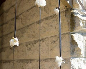 Hanging entrance ribbons of peony blooms - Image by Karen Buckle Photography