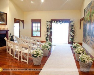 Rustic floral canopy and aisle way basket designs - Image by Focus Films