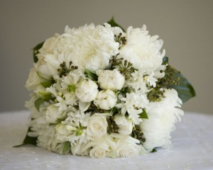 Clustered bouquet of white disbuds, double tulips and hyacinth.