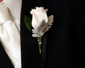 Ivory Vendella rose buttonhole with a touch of silver Dusty Miller