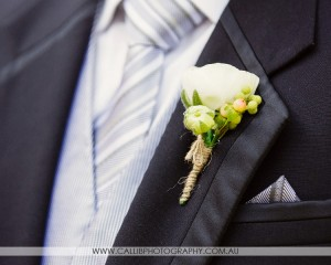 Ranuncula and berry buttonhole with twine finish.