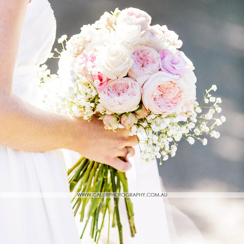 Vintage design including David Austin roses, lisianthus, spray roses and baby's breath.