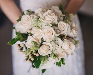 Classic ivory design of Vendella roses, lisianthus, delphinium, berry and gardenia folaige. Image by Todd Hunter McGaw Photography